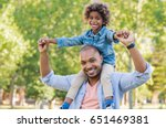 smiling father holding his son... | Shutterstock . vector #651469381