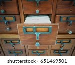 Small photo of Vintage color image for open wooden boxes with index cards in library, Selective focus and Close up image