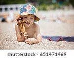 sweet little child  boy  eating ... | Shutterstock . vector #651471469