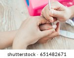 girl cleans cuticles  preparing ... | Shutterstock . vector #651482671