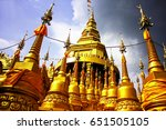 golden pagoda in thailand | Shutterstock . vector #651505105