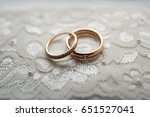 golden wedding rings lie on... | Shutterstock . vector #651527041