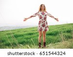 women with arms wide open   Shutterstock . vector #651544324