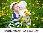 children in a field of flowers | Shutterstock . vector #651561229