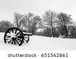 Two Old Cannons In Snow At...