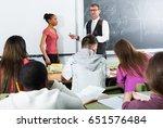 positive senior man giving a... | Shutterstock . vector #651576484