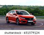 Small photo of ISTANBUL - JUNE: The Honda Civic RS with the tenth generation of red color. June, 2017 Istanbul. Japanese automotive brand established by Soichiro Honda
