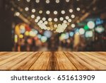 empty wooden table and blurred... | Shutterstock . vector #651613909