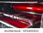 Small photo of offset machine press print magenta ink unit rollers