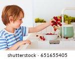 cute young boy washing the...   Shutterstock . vector #651655405