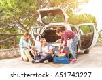 happy young people pack their... | Shutterstock . vector #651743227