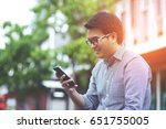 close up of young man using... | Shutterstock . vector #651755005