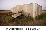 Old farm shed and machinery in rural Australia at dusk - stock photo
