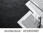 Small photo of business accounter work with taxes and keyboard on black office desk top view space for text