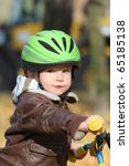 Baby Boy In Helmet Learning To...