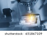 Small photo of The CNC milling machine cutting the sample part with the small end-mill in light blue scene.Hi-precision CNC machining concept.