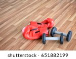 red boxing glove and dumbbells... | Shutterstock . vector #651882199