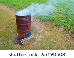 A Burn Barrel Burning A Pile O...