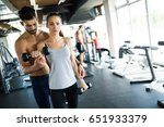 personal trainer assisting... | Shutterstock . vector #651933379
