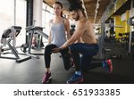 personal trainer assisting... | Shutterstock . vector #651933385