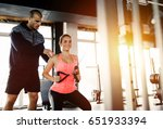 personal trainer assisting... | Shutterstock . vector #651933394