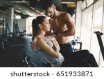 personal trainer helping woman... | Shutterstock . vector #651933871