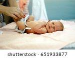parent changing newborn's... | Shutterstock . vector #651933877