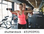 personal trainer helping woman... | Shutterstock . vector #651933931