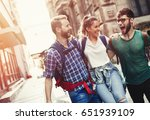 happy group of tourists... | Shutterstock . vector #651939109