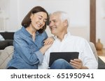 mature couple at home... | Shutterstock . vector #651950941
