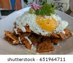 breakfast chilaquiles dish with ...