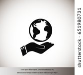 globe icon with hand    vector... | Shutterstock .eps vector #651980731