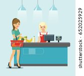 supermarket cashier at the cash ... | Shutterstock .eps vector #652025929