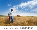 young handsome farmer standing... | Shutterstock . vector #652033555