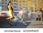 model in yellow coat on mall... | Shutterstock . vector #652049605