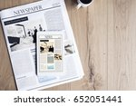 newspaper with tablet on wooden ... | Shutterstock . vector #652051441