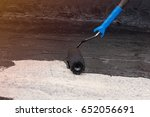 worker covered surface  bitumen ... | Shutterstock . vector #652056691