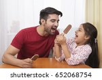 father sharing ice cream with...   Shutterstock . vector #652068754