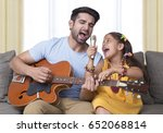 father and daughter singing... | Shutterstock . vector #652068814