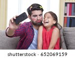 father wearing make up pulling... | Shutterstock . vector #652069159