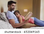 father reading story to... | Shutterstock . vector #652069165