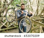 hipster man holding his bicycle ... | Shutterstock . vector #652070209