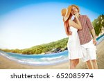 two young lovers on beach and... | Shutterstock . vector #652085974