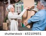 smiling senior couple holding... | Shutterstock . vector #652109851