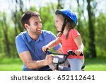 girl learning to ride a bicycle ... | Shutterstock . vector #652112641