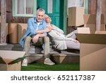happy senior couple sitting... | Shutterstock . vector #652117387