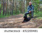 A Hiker With His Dog Takes A...