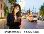 business woman use cellphone in ... | Shutterstock . vector #652224301