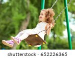 child swinging on a swing at ... | Shutterstock . vector #652226365