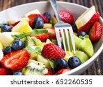 fresh fruits salad and fork in... | Shutterstock . vector #652260535